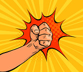 Fist punching or strong punch drawn in pop art retro comic style. Cartoon vector illustration