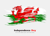 Flag of Wales. Independence Day. Flag in grungy style. Flag painted with a brush with paint. Grungy flag. Grungy style. Brushstroke. Use for brochures, printed materials, icons, logos, signs,  element