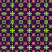 Abstract fleur de lys on seamless pattern (desaturated colors pink and green on dark background), vector illustration.