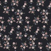Floral seamless pattern of small flowers in pastel colors on a dark blue background