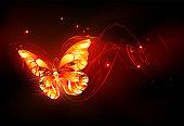 Flying fiery sparkling fire butterfly on black background.