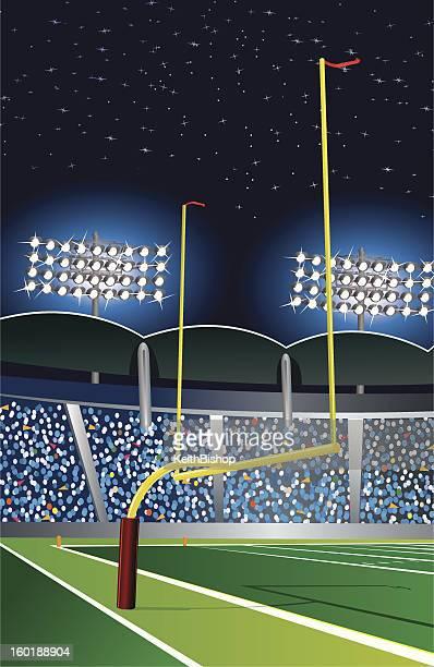 Football Goal Post Under Stadium Lights at Night