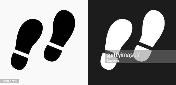 Footprints Icon on Black and White Vector Backgrounds