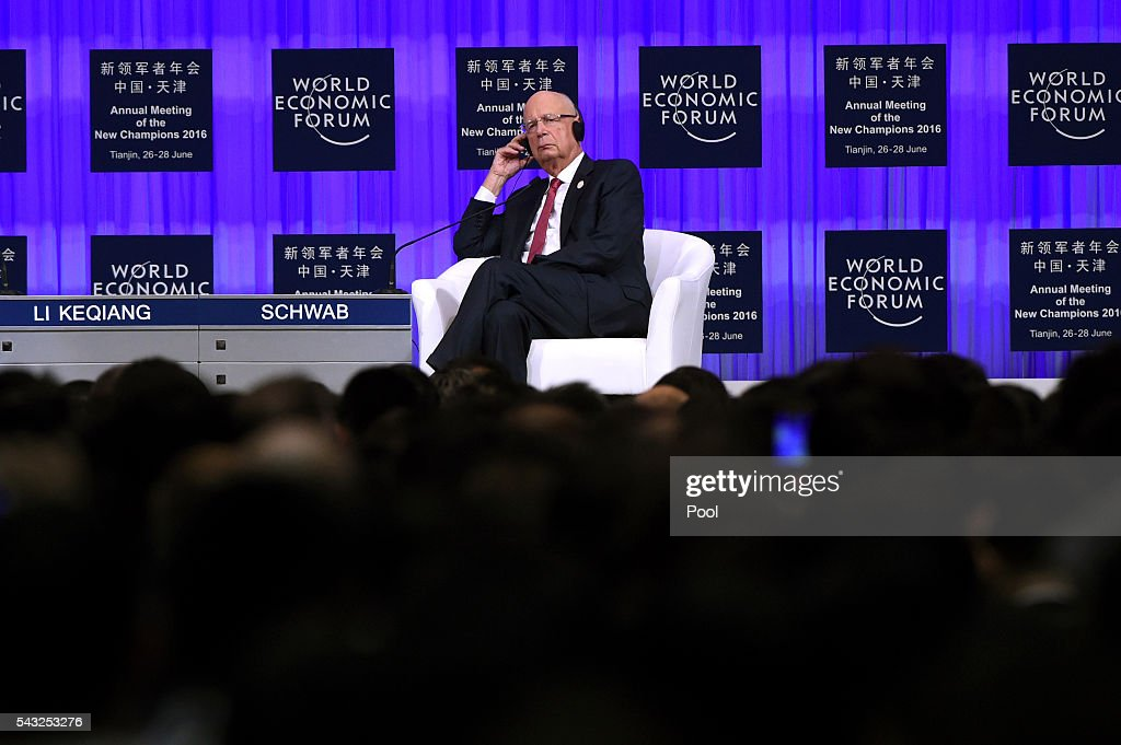 Founder and executive chairman of the WEF <a gi-track='captionPersonalityLinkClicked' href=/galleries/search?phrase=Klaus+Schwab&family=editorial&specificpeople=569943 ng-click='$event.stopPropagation()'>Klaus Schwab</a> listens as Chinese Premier Li Keqiang gives a speech during the World Economic Forum on June 27, 2016 in Tianjin, China. The annual World Economic Forum New Champions meeting brings together business, economic and political leaders and former officeholders.