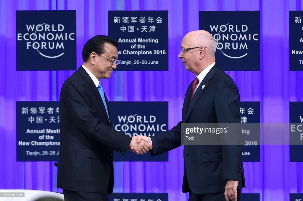 Founder and executive chairman of the WEF <a gi-track='captionPersonalityLinkClicked' href=/galleries/search?phrase=Klaus+Schwab&family=editorial&specificpeople=569943 ng-click='$event.stopPropagation()'>Klaus Schwab</a> (R) shakes hands with Chinese Premier <a gi-track='captionPersonalityLinkClicked' href=/galleries/search?phrase=Li+Keqiang&family=editorial&specificpeople=2481781 ng-click='$event.stopPropagation()'>Li Keqiang</a> during the World Economic Forum on June 27, 2016 in Tianjin, China. The annual World Economic Forum New Champions meeting brings together business, economic and political leaders and former officeholders.