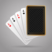 Four aces in five playing card with black back design on gray background. Winning poker hand
