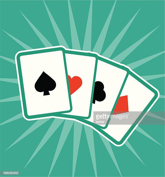 Four different playing cards showing each suit