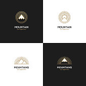 Set of four linear mountain symbol in golden color on black and white backgrounds. Sport camp, travel, tourism, adventure symbol.