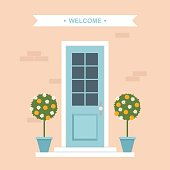 Vector illustration of house entrance door with potted orange trees.