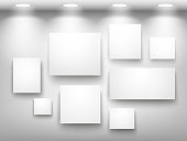 Gallery of empty frames on the wall with lighting