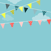 Bright garlands with triangular flags with different patterns are hanging against a blue sky background Illustration in flat style