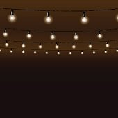 Garland of lamps on brown background. Vector illustration.