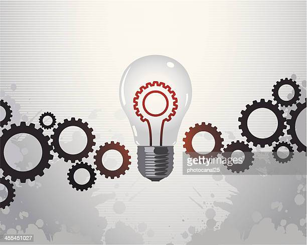 Gears and a light bulb representing a solution concept