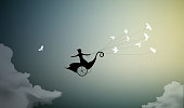 girl is flying on fairy carriage and holding flock of pigeons, fly to the sun, fly away from the storm,before the rain storm, silhouette.