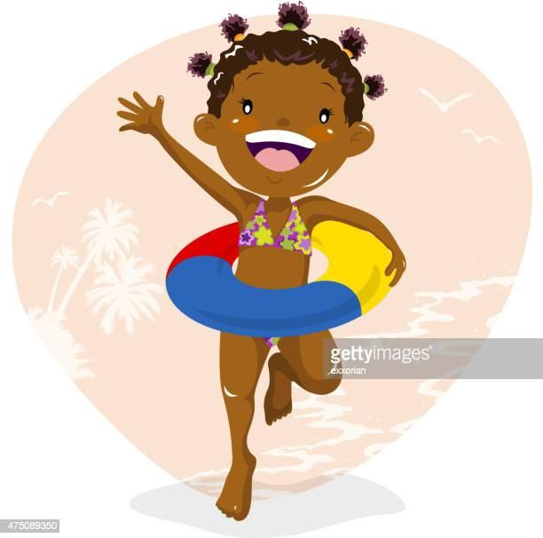 Girl wearing inner tube at beach
