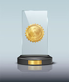 Glass award with gold medal isolated on blue background. Vector illustration.