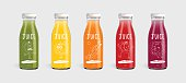Glass juice bottle brand concept isolated on light gray background. Packaging vector. Kiwi, Orange, Carrot, Tomato and blackberry cartoon character