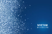 Glitter confetti, snow falling from the side. Vector dust, explosion on blue background. Sparkling border, frame. Great for wedding invitations, party posters, Christmas and birthday cards.