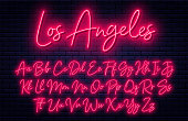 Glowing neon script alphabet. Neon font with uppercase and lowercase letters. Handwritten english alphabet with neon light effect
