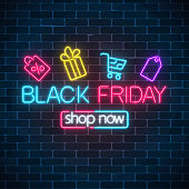 Glowing neon sign of black friday sale with shopping symbols on dark brick wall background. Seasonal sale web banner. Vector illustration. Black friday light signboard.