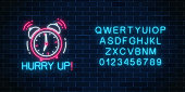 Glowing neon sign with alarm clock, hurry up text and alphabet on dark brick wall background. Call to action symbol with cheering inscription and letters font. Its time to work. Vector illustration.