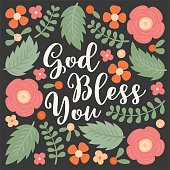 God bless you hand lettering quote with floral and leaves doodles, for used as poster or printing on t-shirt, bag, greeting card