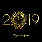 Gold clock with roman numerals on a hexagon disco ball with New Year numerals 2019 in a circular format on a black background