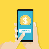 Gold coin and donate button on smartphone screen. Hand holds smartphone, finger touches screen. vector