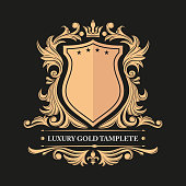Gold decorative floral frame and monogram initials. Vector heraldic templates. Exclusive leafy vintage ornament. Luxury golden pattern.