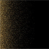 Gold glitter texture on a black background. Golden explosion of confetti. Golden grainy abstract texture on a black background. Design element. Vector illustration.
