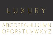 Gold minimalistic font. Luxury english alphabet - rich design