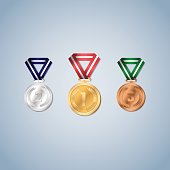 Gold, silver and bronze medals with laurel leaf on the medal face - Vector illustration.