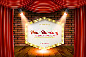 Golden frame in cinematic style on brick wall and red curtain background with spotlights. Vector illustration