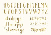 Golden letters. Hand drawn latin font. Vector. Isolated.