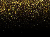 Golden rain isolated on black background. Vector gold grain texture celebratory wallpaper. Chaotic confetti crystals yellow bright illustration