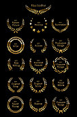 Golden shiny award laurel wreaths isolated on black background. Vector Film Awards design elements