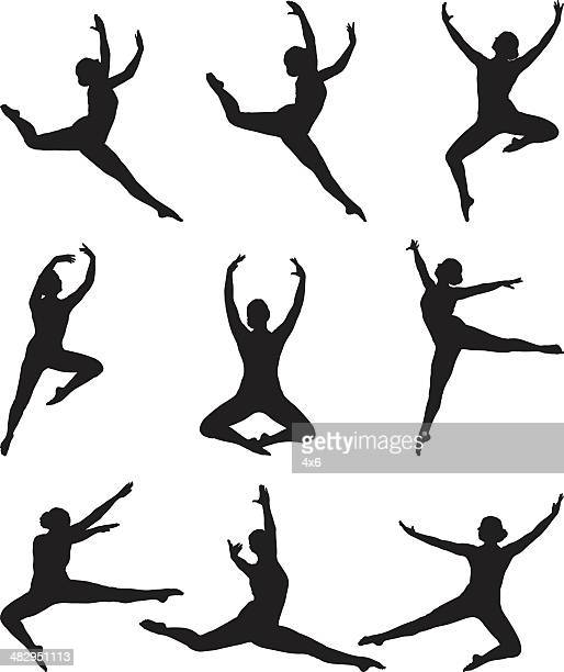 Graceful ballerina mid air leaping poses