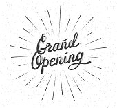 Grand Opening. Distressed background. Lettering Composition with burst. Black and white vector illustration