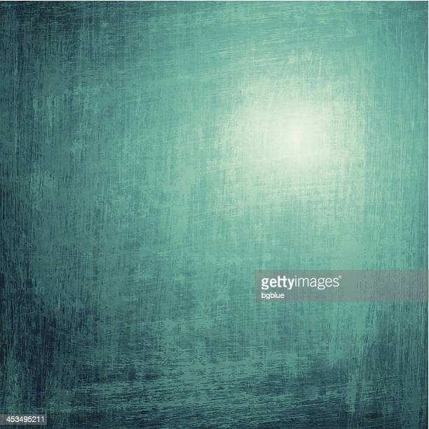 A green grunge background with light