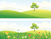 Vector illustration of beautiful green and blooming hills.