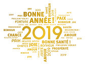 Gold greeting French words around New Year date 2019, isolated on white