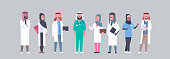 group of arabic doctors team in uniform treatment communication concept arab medical hospital mix race workers traditional clothes full length horizontal vector illustration