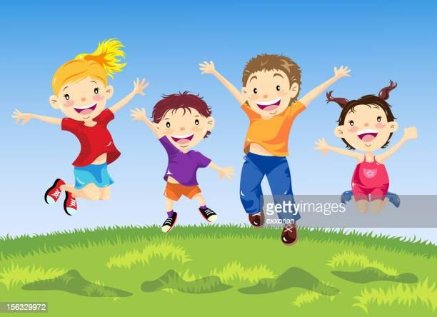 Groupe d'enfants de sauter dans le printemps