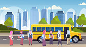 group of muslim arabic children walking in yellow bus pupils transport concept cityscape background flat horizontal full length vector illustration