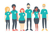 Group of Volunteers wearing same color t-shirts. Multinational people standing happily together. Vector flat isolated image
