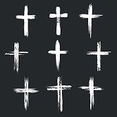 Grunge christian cross icons. White cross icons on black background. Vector illustration