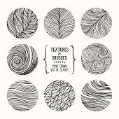 Hand drawn wavy linear textures made with ink. Artistic collection of graphic design elements. Swirl, circle, wavy stripe, abstract line, organic background, geometric pattern. Isolated vector set.