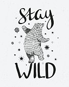 Hand drawn dancing bear. Vector sketch illustration with stylish lettering 'stay wild'.