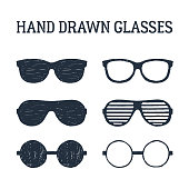 Hand drawn eye glasses and sunglasses textured vector illustrations set.