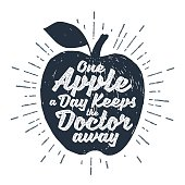"""Hand drawn label with textured apple vector illustration and """"One apple a day keeps the doctor away"""" lettering."""